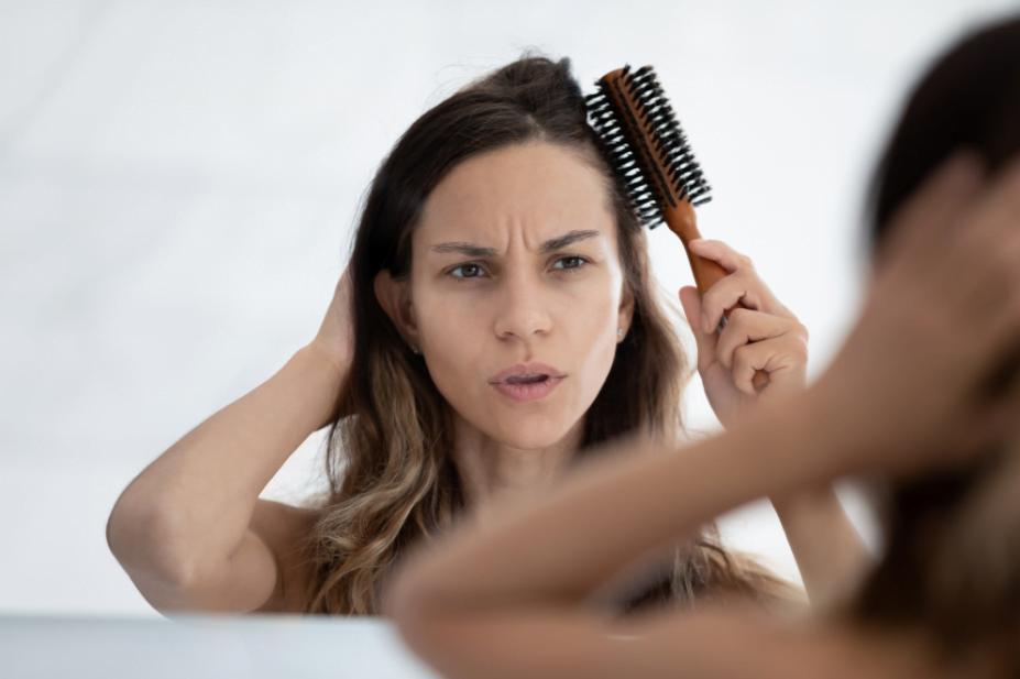 hair thinning woman mirror maxim hair restoration